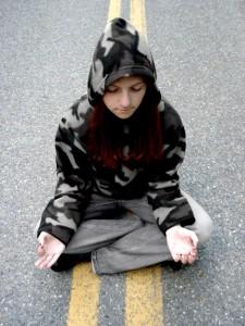meditating on street - maslows needs